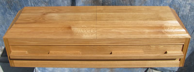 Premier Oak Casket with light stain.