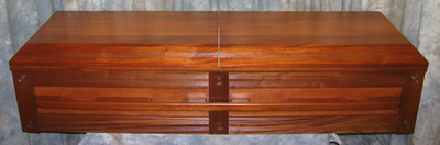 premier Mahogany wood casket w/center split lid.